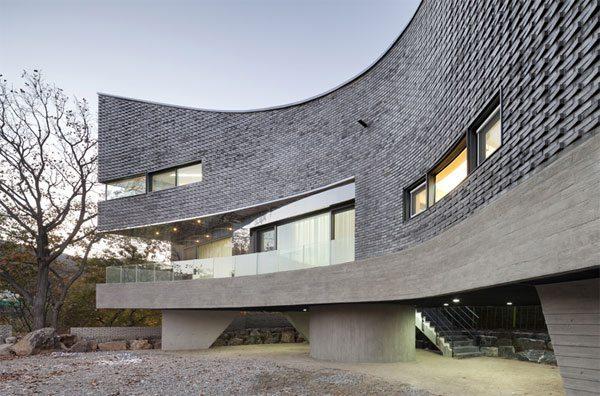 Casa con curvas en corea del sur for Casa moderna corea